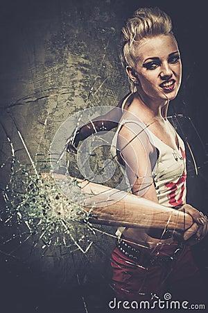 O Orfanato - Página 2 Troubled-teenager-punk-girl-breaking-glass-baseball-bat-47732862