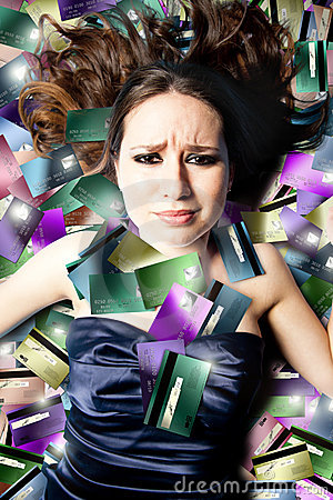 Troubled woman lying on credit cards