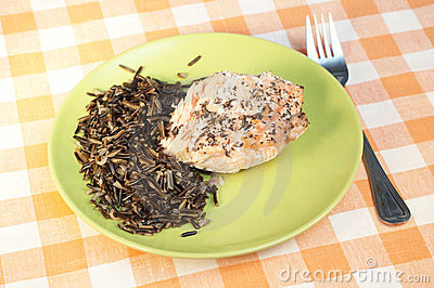 Trout baked with spices and wild rice