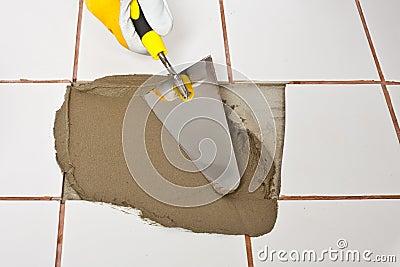 Trowel puts adhesive on hole