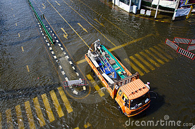 Truck carries a boat to help flood victims. Editorial Image