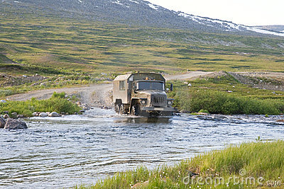 Truck crossing a river