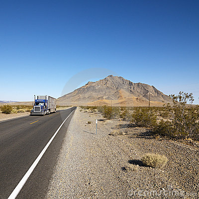 Truck on desert road.