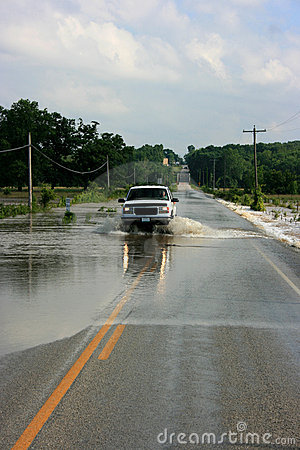 Truck Driving on Flooded Road Editorial Stock Image