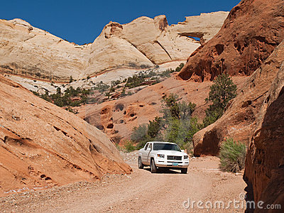 Truck driving through narrow desert canyon