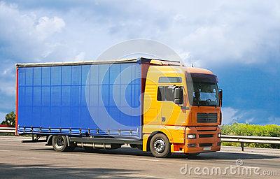 Truck goes on the way to sky background