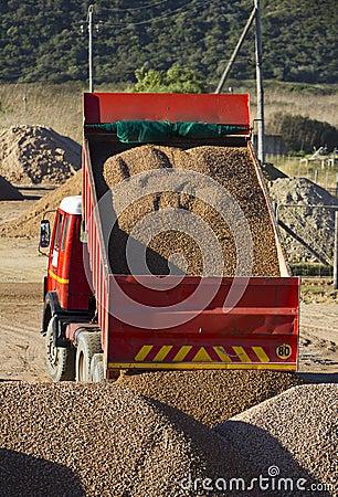 Truck offloading gravel