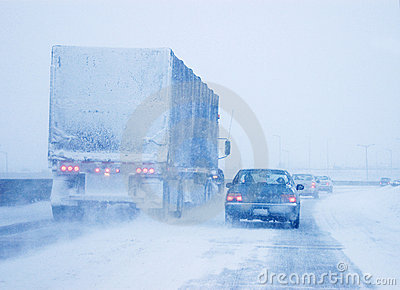 Truck and Passenger Car in Whiteout Driving Condit Editorial Stock Image