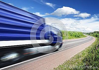 Truck speeding on country highway, motion blur