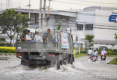 Truck support employee on the road between Water flooding attack Editorial Image