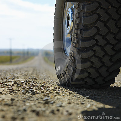 Free Truck Tire On Gravel Road. Stock Photography - 2051832