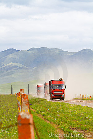 Trucks passing through grassland