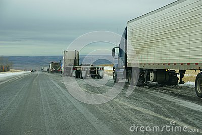Trucks stop to remove chains