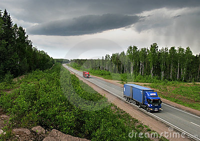trucks and storm weather on Highway Scandinavia