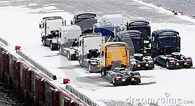 Trucks waits on snowbound pier