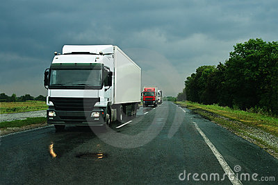 Trucks on wet asphalt