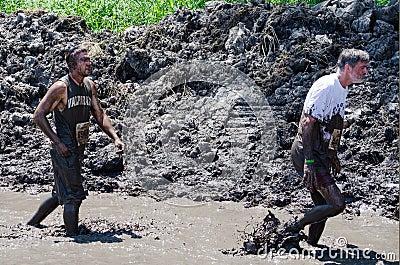 Trudging through mud Editorial Image