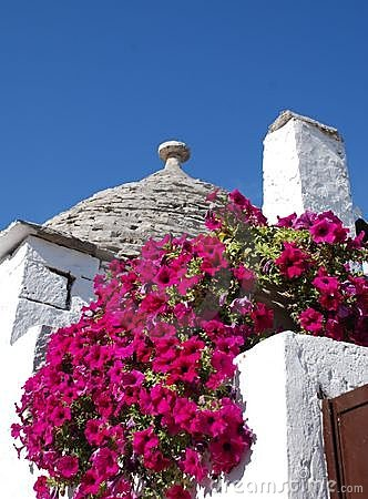 Free Trullo Roof With Pink Flowers 3 Stock Photo - 6377050