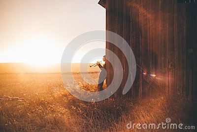 Trumpet Player By Barn At Sunset Free Public Domain Cc0 Image