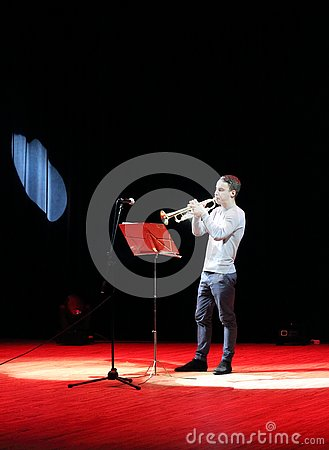 Free Trumpeter Musician In Red Spotlights Royalty Free Stock Images - 81449669