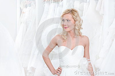 Trying a beautiful wedding gown on