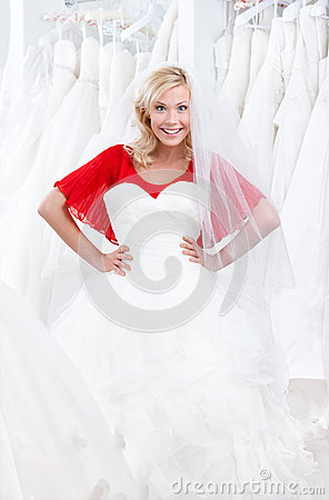 Trying a fascinating wedding gown on