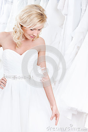 Free Trying On A Charming Wedding Gown Royalty Free Stock Photos - 25739648