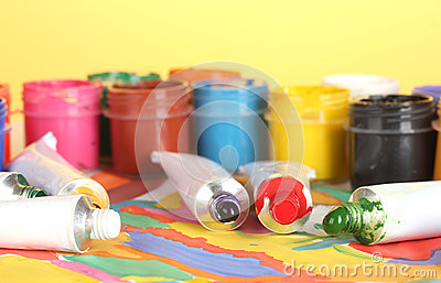 Tubes with colorful watercolor and jars