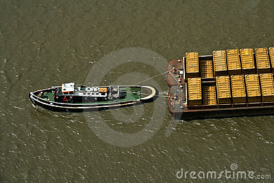 Tug boat pulling refuse containers