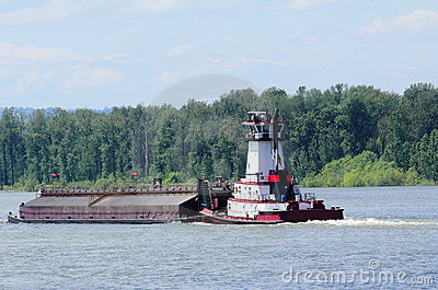 Tugboat Pushing a Heavy Barge