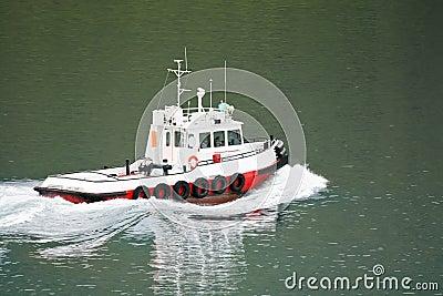 Tug boat at seaport