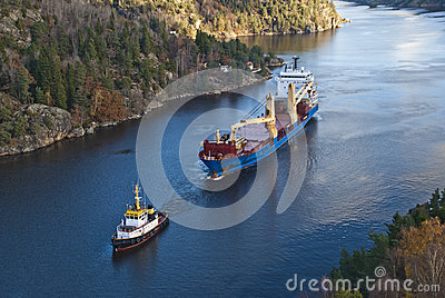 Tug hebert are towing bbc europe out of the fjord