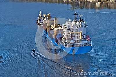 Tug herbert are towing bbc europe out of the fjord