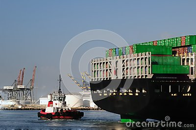 Tugboat and back of container ship