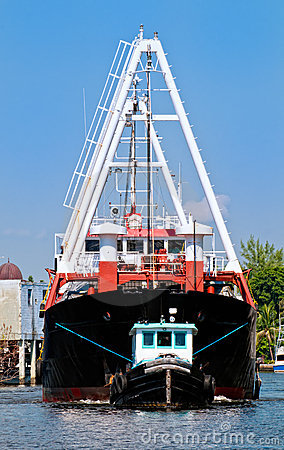 Tugboat and Cargo Ship