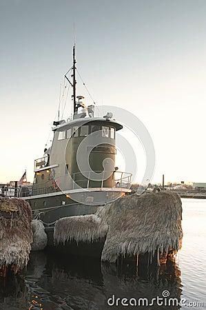Tugboat docked in harbor