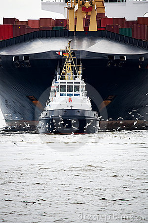 Free Tugboat Pulling Freighter Stock Image - 9894621