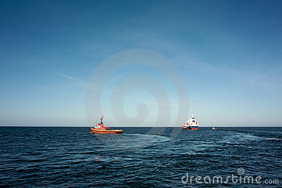 Tugs and vessel.