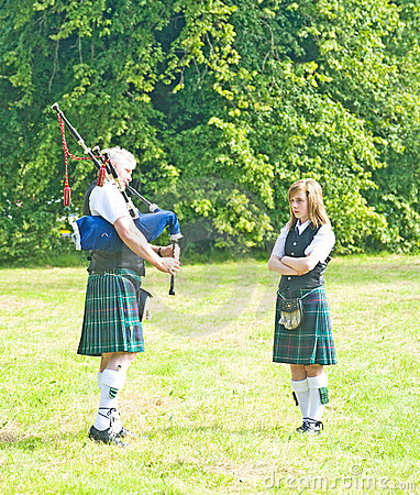 Tuition: playing the Bagpipes. Editorial Photo