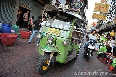 A Tuk-Tuk Taxi on a Chinatown Street in Bangkok Editorial Image