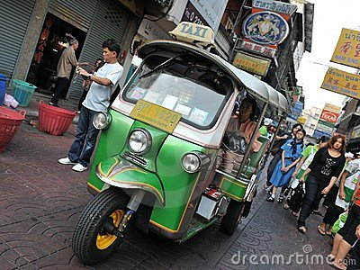 A Tuk-Tuk Taxi on a Chinatown Street in Bangkok Editorial Photography