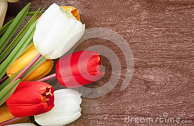Tulip flower bouquet on weed texture background