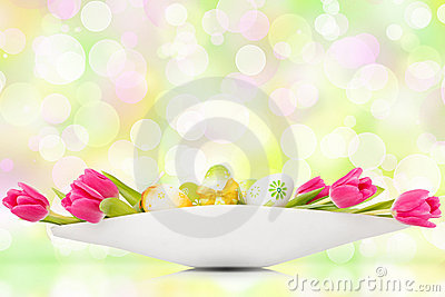 Tulips and easter eggs before bokeh background