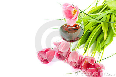 Tulips and glass of wine isolated on white