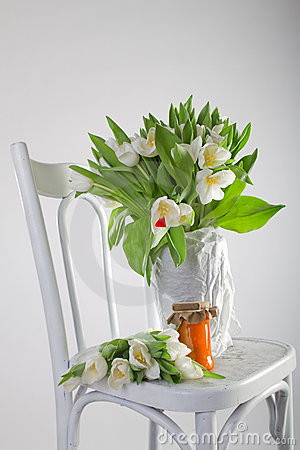 Tulips, orange and pumpkin marmalade on old chair
