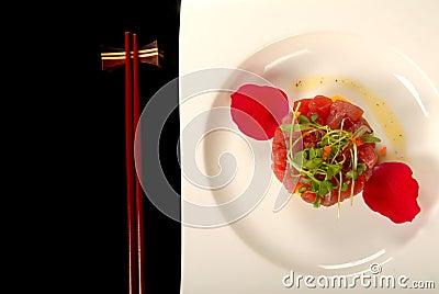 Tuna, mango and cucumber tartare with chop sticks