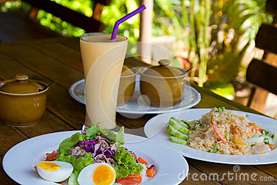 Tuna salad, rice with seafood and cocktail