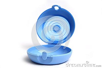 Blue tupperware for sandwich open.