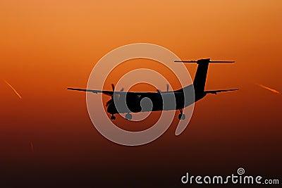 Turboprop plane landing silhouette