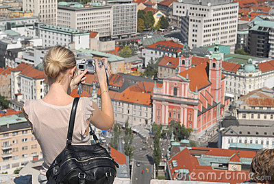 A turist taking a photo of the main city of Slovenia - Ljubljana
